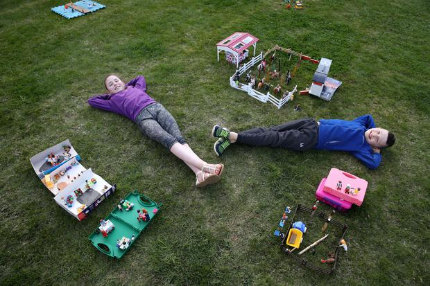 Ailie and Hamish Muirhead beside their toy recreation of the Royal Highland Show (Andrew Milligan/PA)