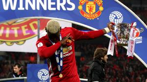 Manchester United's Paul Pogba dabs after the EFL Cup Final at Wembley Stadium, London.
