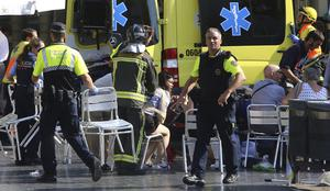 Injured people are tended to by emergency services