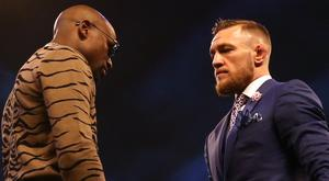 Conor McGregor and Floyd Mayweather will go head to head in the ring (Scott Heavey/PA)