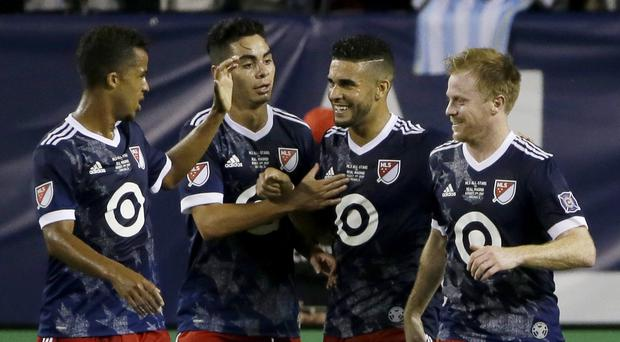 MLS All-Stars footballer Dom Dwyer celebrates scoring against Real Madrid – (Nam Y. Huh/AP)