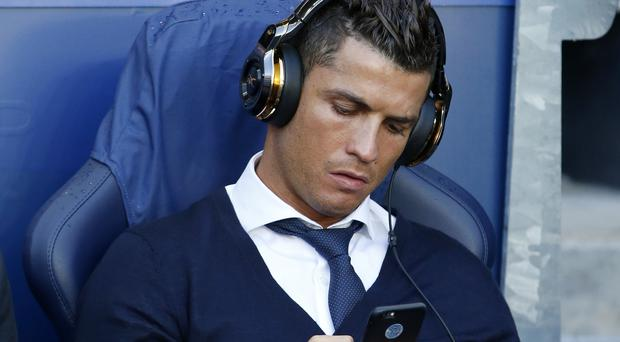 Cristiano Ronaldo ahead of a Champions League game – (Peter Byrne/PA)