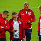 Wayne Rooney shares a joke with his England team mates