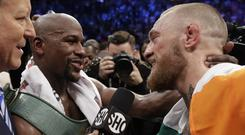 Floyd Mayweather and Conor McGregor speak after their boxing match