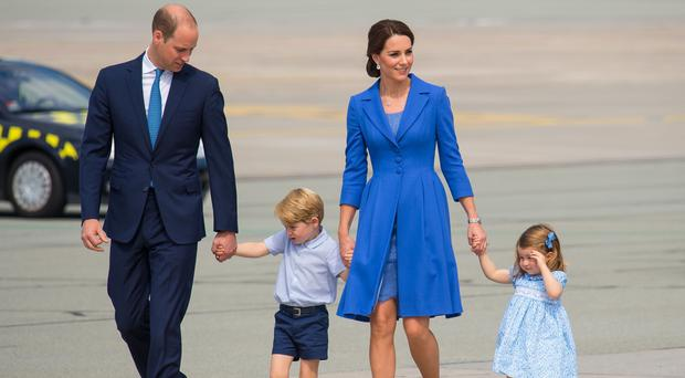 The Duke and Duchess of Cambridge, Prince George and Princess Charlotte in Poland earlier this year (Dominic Lipinski/PA)