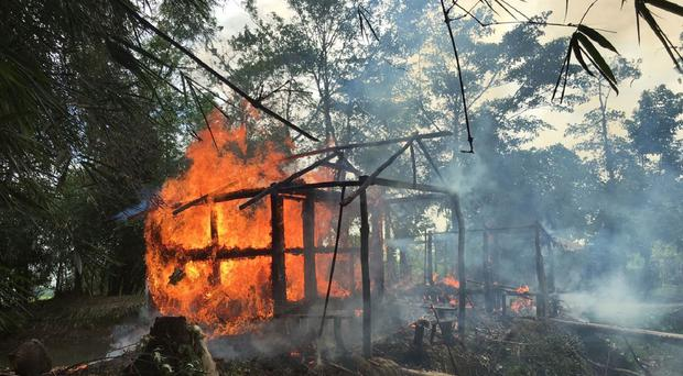Houses on fire in Gawdu Zara village in Burma (AP)
