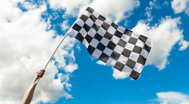 A chequered flag waving in the wind