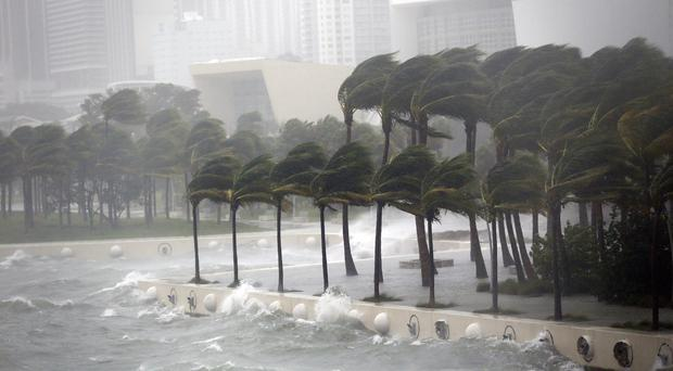 Waves crash over a seawall from Biscayne Bay as Hurricane Irma passes by
