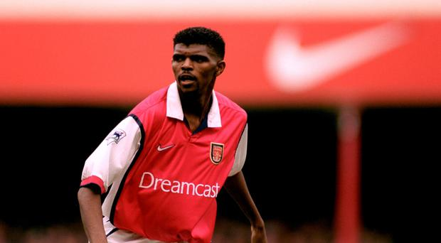 Nwankwo Kanu playing for Arsenal