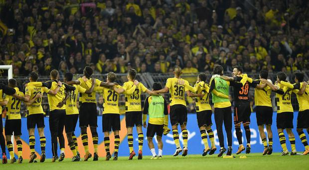 Borussia Dortmund celebrate in front of their supporters
