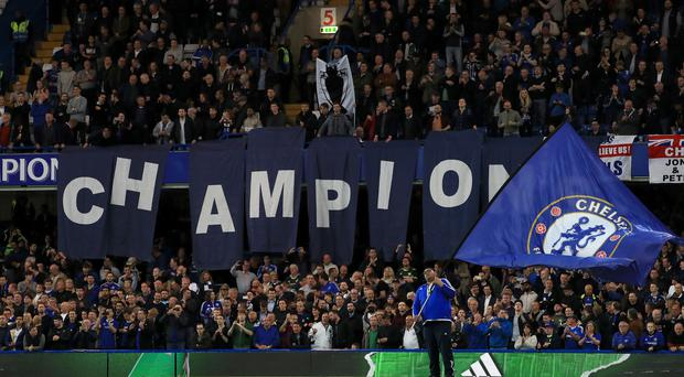 A banner reading 'Champions' is displayed prior to the match