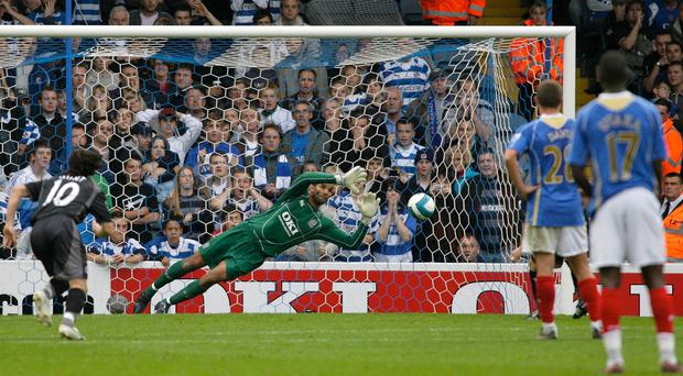Portsmouth's David James saves a penalty during a game against Reading