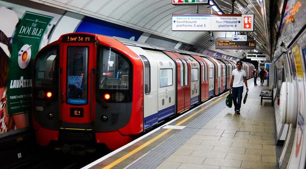 A tube train leaves Oxford Circus station (Martin Keene/PA)