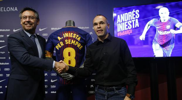 Andres Iniesta signs a lifetime contract with Barcelona