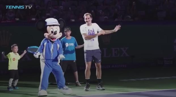 Roger Federer plays tennis with Mickey Mouse