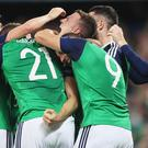 Northern Ireland footballers celebrate a goal in World Cup qualifying