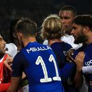 Everton and Lyon players clash during their Europa League game