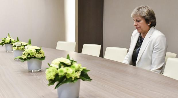 Theresa May sits alone (Geert Vanden Wijngaert/AP/PA)