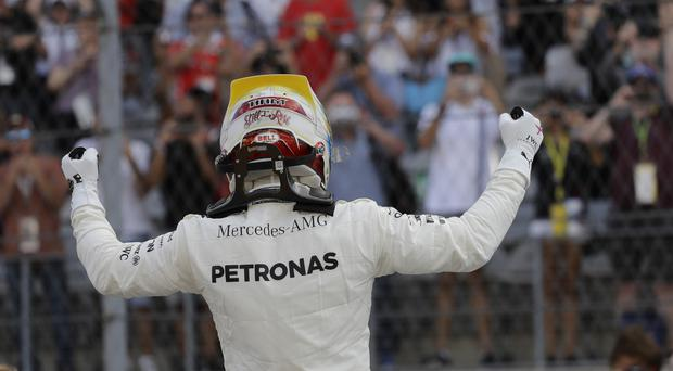Lewis Hamilton reacts after winning the 2017 US Grand Prix