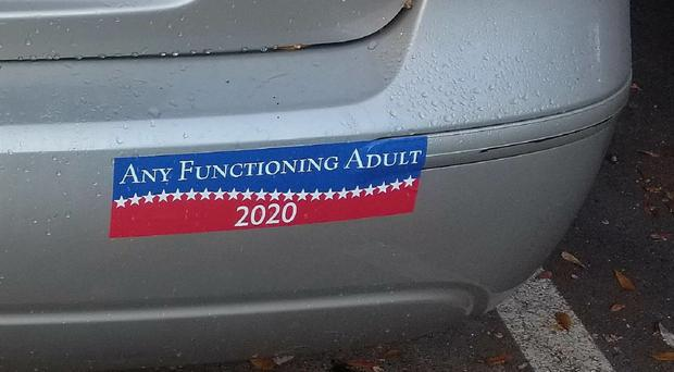 The bumper sticker on the car