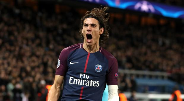 Paris Saint-Germain's Edinson Cavani celebrates scoring his side's sixth goal of the game