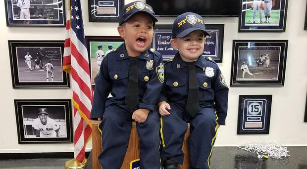 Twins Aaron and Evan Rolon who dress up as cops and have a miniature squad car at the age of three ((Alejandro Rolon and Kelly Caceres)