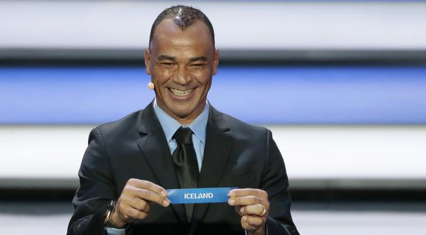 Former Brazilian soccer international Cafu holds up the team name of Iceland at the 2018 soccer World Cup draw in the Kremlin