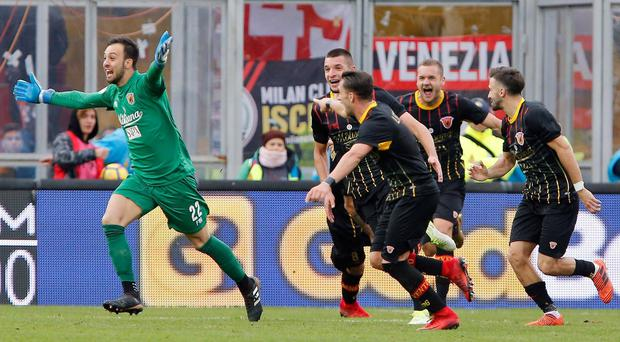 Benevento goalkeeper Alberto Brignoli, left, celebrates after scoring the equalizer at the end of the Italian Serie A soccer match.