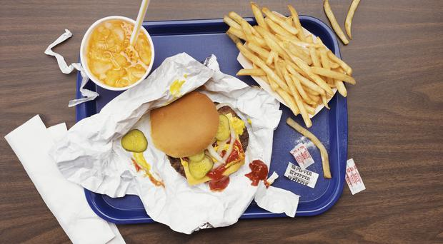 Elevated View of a Tray With Fries, a Hamburger and Lemonade (Thinkstock/PA)