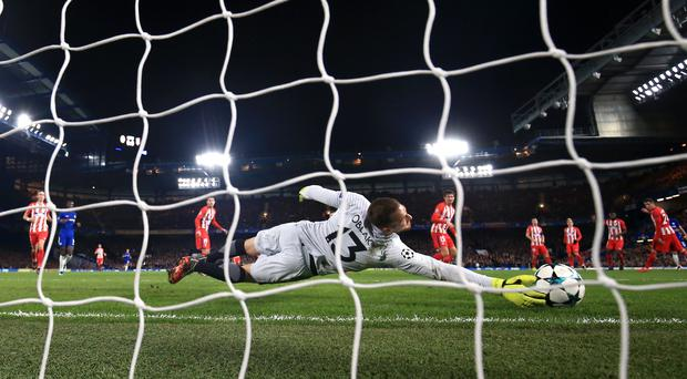 Atletico Madrid goalkeeper Jan Oblak blocks a shot against Chelsea in the Champions League