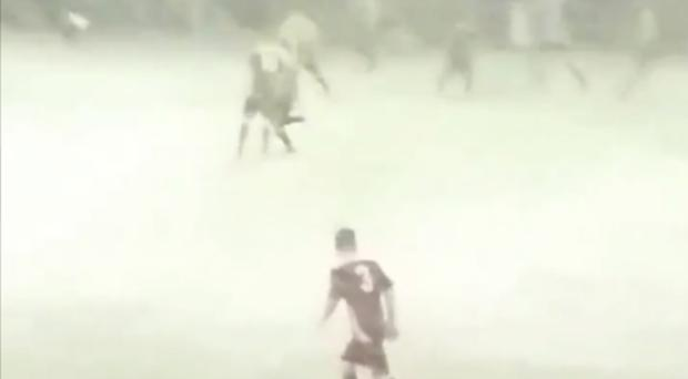 A snowy football match in Wales (Risca United/PA)