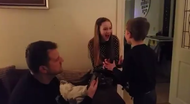 Dad Danny McDonagh breaks the news to Ciara, 10, and Ruairí, 6 that their school is having a snow day. (Screengrab/PA)
