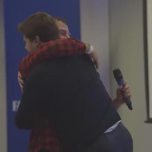 Spurs fan Melvyn Xuereb gets a hug from manager Mauricio Pochettino (Spurs TV)