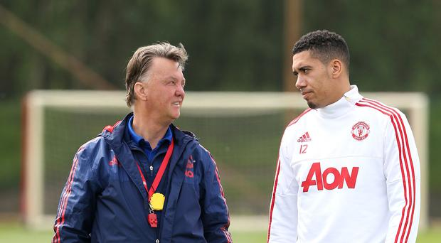 Former Manchester United manager Louis van Gaal with Chris Smalling