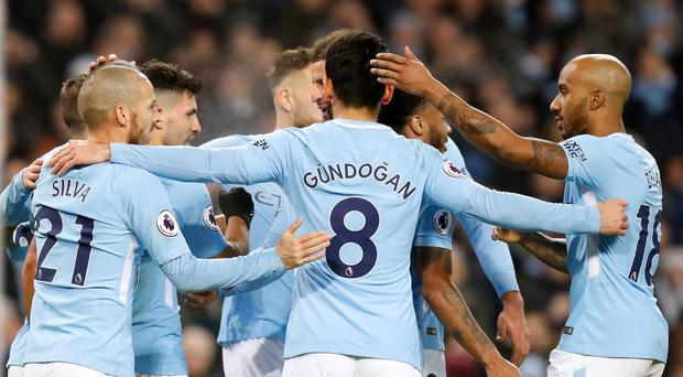 Manchester City celebrate a goal in the Premier League