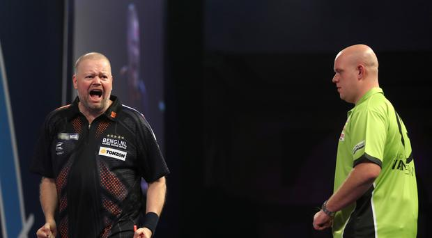 Raymond van Barneveld (left) reacts during the PDC World Championship