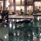 A university student at Texas AandM University slides across an icy pool