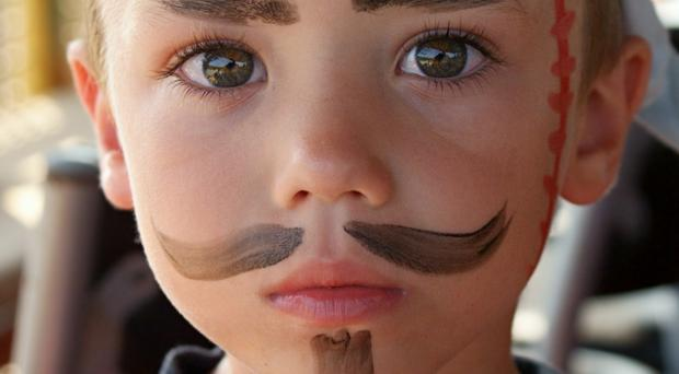 A child in pirate makeup