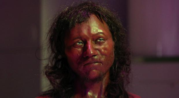DNA suggests ancient man had dark skin, blue eyes