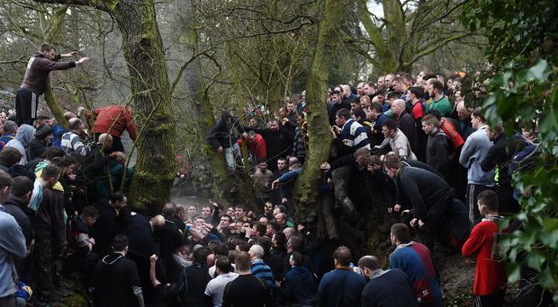 Players during the Royal Shrovetide Football match in Ashbourne, Derbyshire (Joe Giddens/PA)