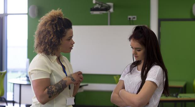 Teacher telling off teenage student (DGLimages/Getty Images)