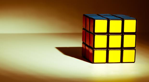 The fastest official time for a human to solve a Rubik's Cube is 4.69 seconds (Neil Kendall/Getty Images/PA)