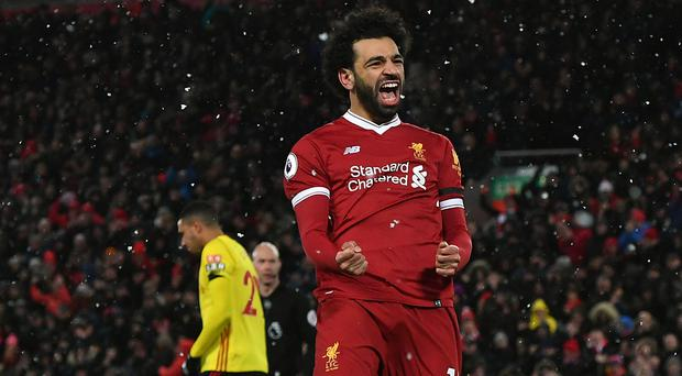 Liverpool's Mohamed Salah celebrates scoring a hat-trick during a Premier League match at Anfield, Liverpool