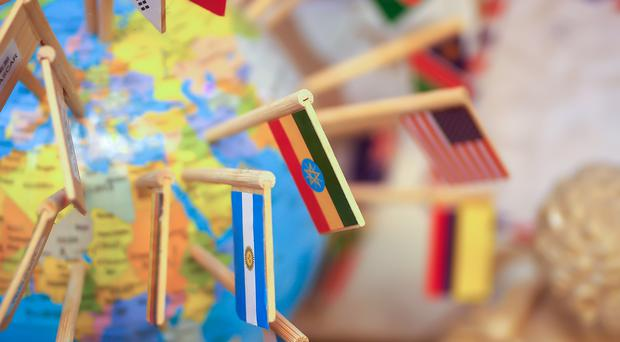 Globe with flags on cocktail sticks (User5dc95804_908/Getty Images)