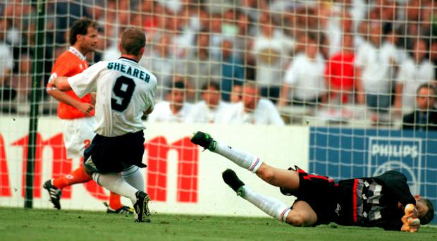 England's Alan Shearer scores against the Netherlands at Euro 96 (Neal Simpson/EMPICS Sport)