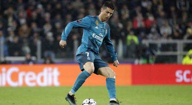 Cristiano Ronaldo controls the ball during a Champions League game