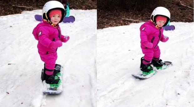 Toddler snowboarding