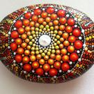 A painted rock - mandala style