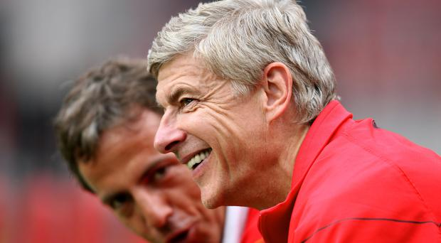 Arsene Wenger sees the funny side (Barry Coombs/Empics Sport)