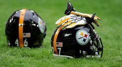 Pittsburgh Steelers quarterback Mason Rudolph was hit with his own helmet by the Cleveland Browns' Myles Barrett (Simon Cooper/PA)
